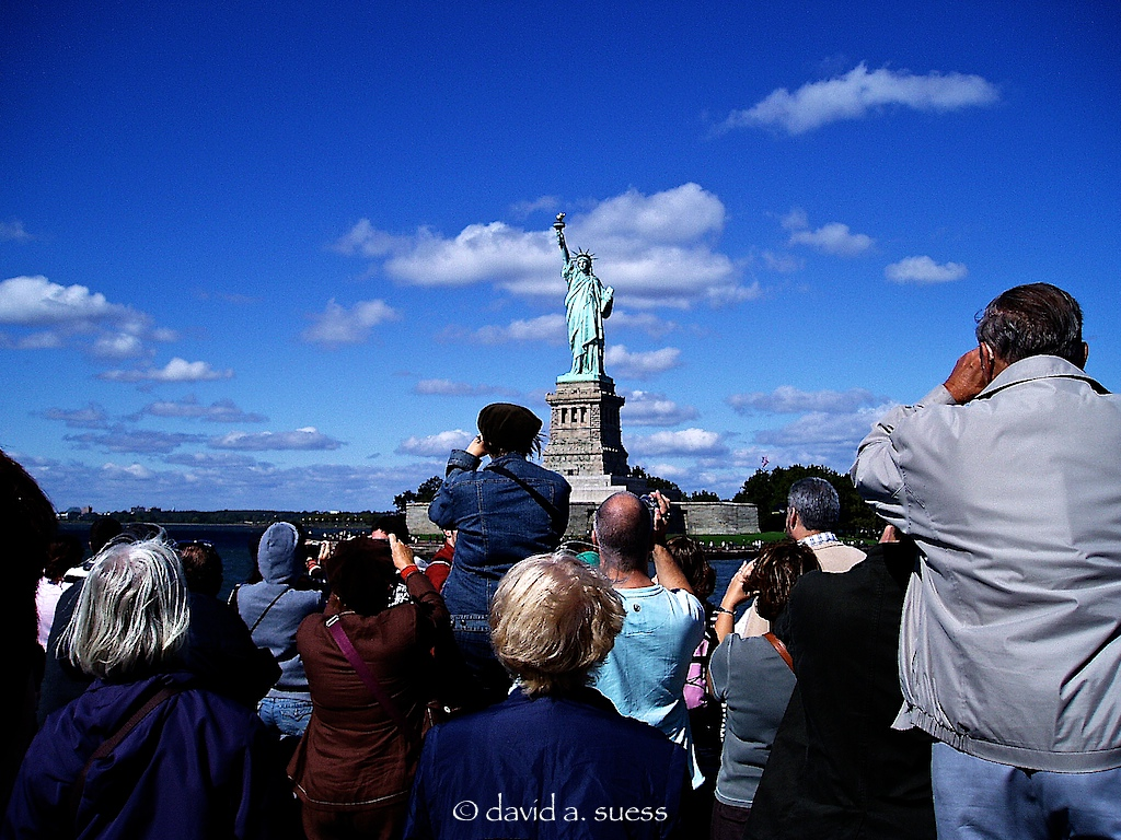 Tourist photographing tourists photographing the Statue of Liberty