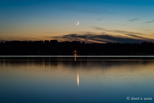 Crescent Moon and Cabin Lights at Dusk